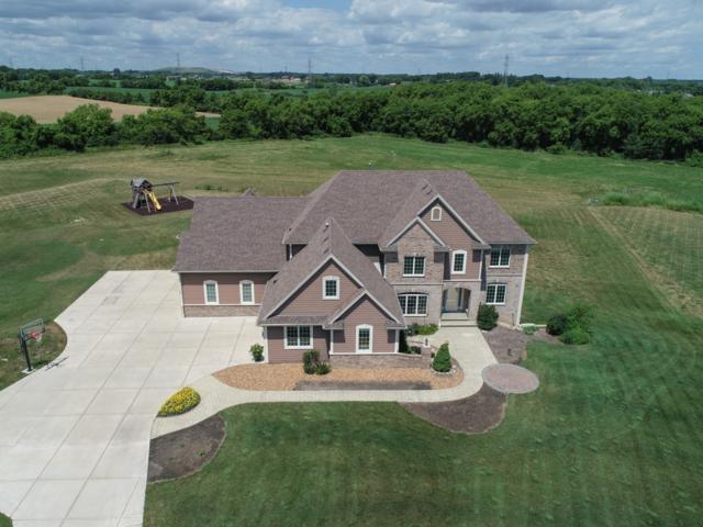 8224 W Stone Creek Cir, Raymond, WI 53108 (#1653120) :: Tom Didier Real Estate Team
