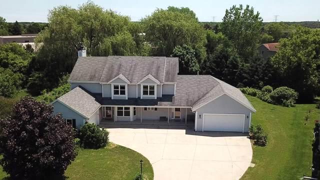 W196N11268 Shadow Wood Ln, Germantown, WI 53022 (#1679983) :: Tom Didier Real Estate Team