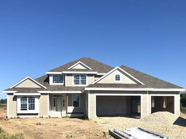 10931 N Spartan Cir, Mequon, WI 53097 (#1685057) :: OneTrust Real Estate