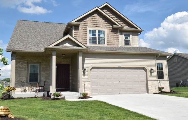 N8262 Woody Ln, Ixonia, WI 53036 (#1692350) :: RE/MAX Service First Service First Pros