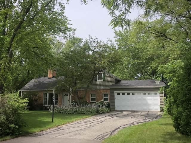8119 N Poplar Dr, Fox Point, WI 53217 (#1699220) :: Tom Didier Real Estate Team