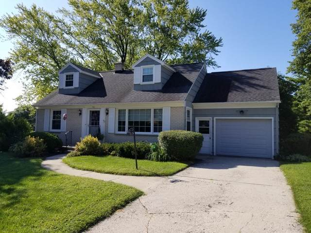 705 Spring Dr, West Bend, WI 53095 (#1702921) :: RE/MAX Service First Service First Pros