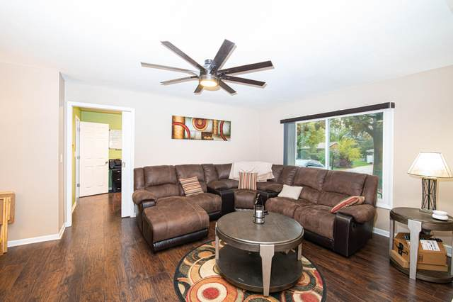 7051 N 97th St, Milwaukee, WI 53224 (#1716070) :: RE/MAX Service First Service First Pros