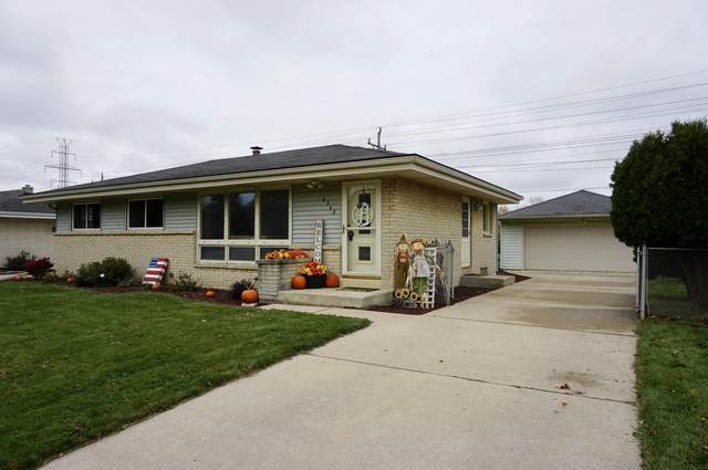6342 W Plainfield Ave, Greenfield, WI 53220 (#1716448) :: Tom Didier Real Estate Team