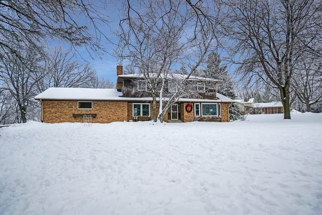 1876 Woodsfield Dr, Richfield, WI 53076 (#1721470) :: Tom Didier Real Estate Team