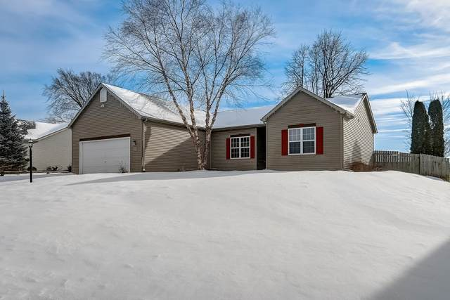 W1035 Snowyowl Ln, Ixonia, WI 53036 (#1724681) :: Tom Didier Real Estate Team