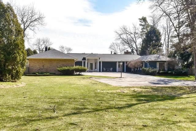 7966 N Beach Dr, Fox Point, WI 53217 (#1726199) :: Tom Didier Real Estate Team