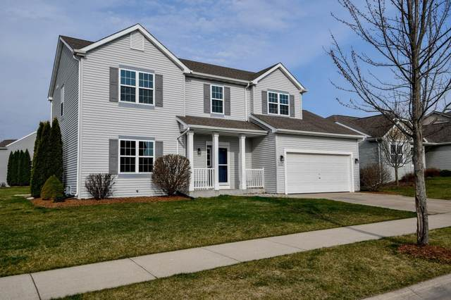 1329 Dovetail Dr, Hartford, WI 53027 (#1733748) :: RE/MAX Service First