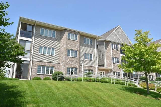 2103 1st Ave #106, Grafton, WI 53024 (#1747925) :: Tom Didier Real Estate Team
