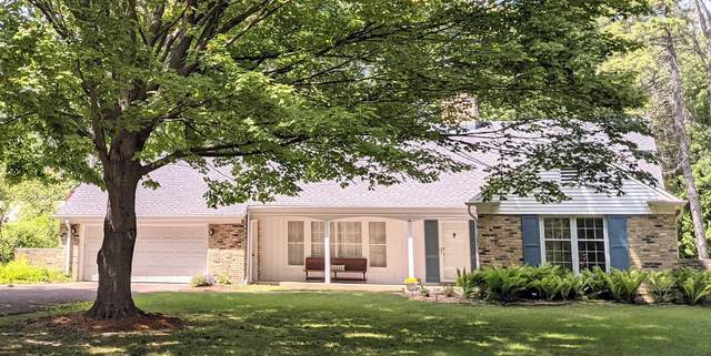 404 E 4 Mile Rd, Wind Point, WI 53402 (#1748355) :: Tom Didier Real Estate Team
