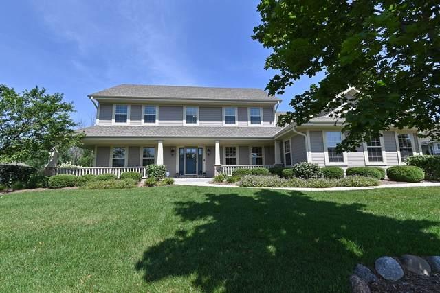 N62W13520 Sunburst  Dr, Menomonee Falls, WI 53051 (#1757965) :: Tom Didier Real Estate Team