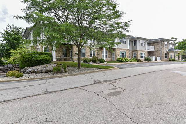 7710 S 51st St #203, Franklin, WI 53132 (#1768020) :: RE/MAX Service First