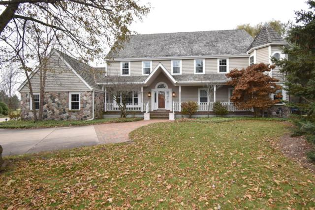 3127 W Woodfield Dr, Mequon, WI 53092 (#1558512) :: Vesta Real Estate Advisors LLC