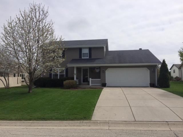 N78W15365 Haymeadow Rd, Menomonee Falls, WI 53051 (#1571535) :: Vesta Real Estate Advisors LLC