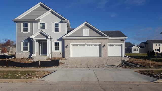 890 Meadowgate Dr, Waterford, WI 53185 (#1590035) :: RE/MAX Service First Service First Pros