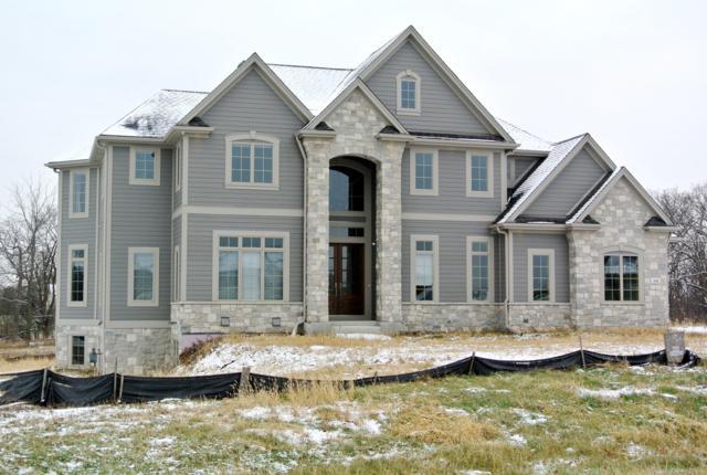 W32N29525 Woodridge Ct, Delafield, WI 53072 (#1609433) :: Tom Didier Real Estate Team