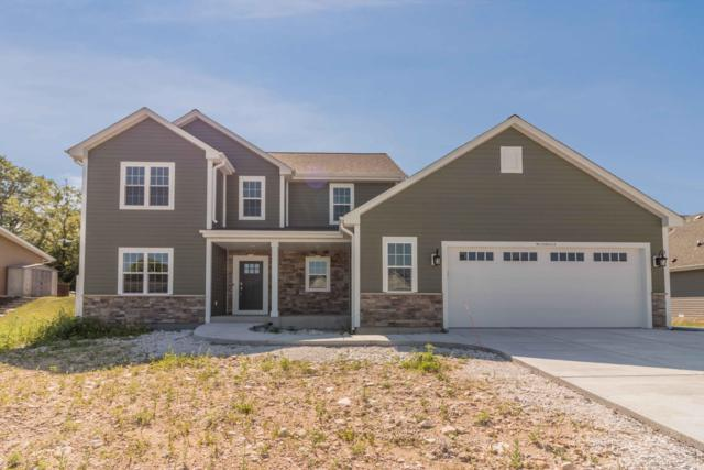 W235N6563 Outer Circle Dr, Sussex, WI 53089 (#1647625) :: Tom Didier Real Estate Team