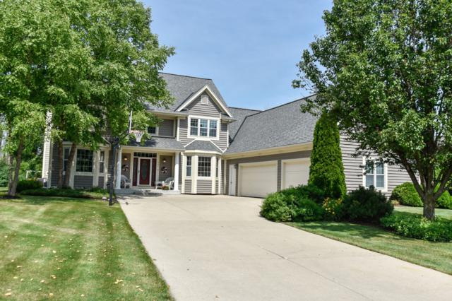 446 Overland Trl, Grafton, WI 53024 (#1648469) :: RE/MAX Service First Service First Pros