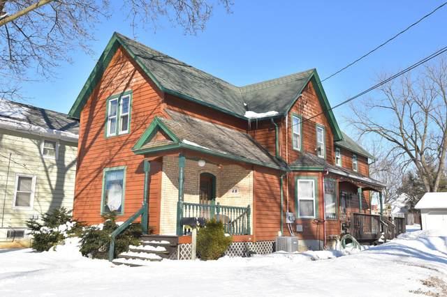 48 Cedar St, Hartford, WI 53027 (#1677632) :: Tom Didier Real Estate Team