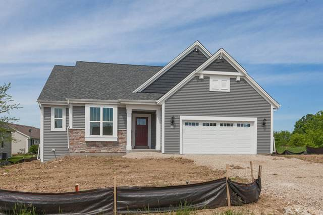 615 Lambert Dr, Slinger, WI 53086 (#1679425) :: RE/MAX Service First Service First Pros