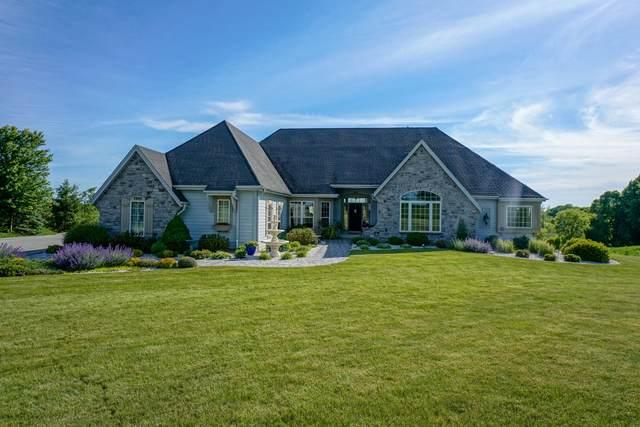 W376N7995 Mcmahon Rd, Oconomowoc, WI 53066 (#1694027) :: NextHome Prime Real Estate