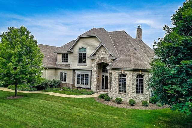 10518 N Stone Creek Dr, Mequon, WI 53092 (#1700002) :: Tom Didier Real Estate Team
