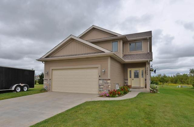 3928 Wild Ginger Way, Caledonia, WI 53126 (#1704638) :: Tom Didier Real Estate Team