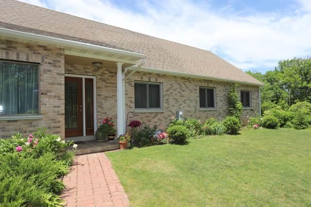 8209 N Port Washington Rd, Fox Point, WI 53217 (#1753608) :: Tom Didier Real Estate Team