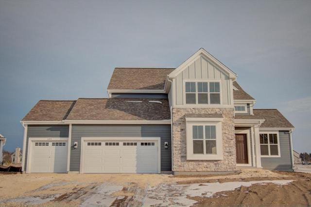 10890 N Spartan Cir, Mequon, WI 53097 (#1543281) :: Vesta Real Estate Advisors LLC