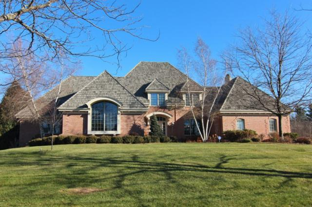 11414 N Justin Dr, Mequon, WI 53092 (#1618500) :: Tom Didier Real Estate Team