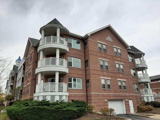 420 57th St #211, Kenosha, WI 53140 (#1716424) :: Tom Didier Real Estate Team