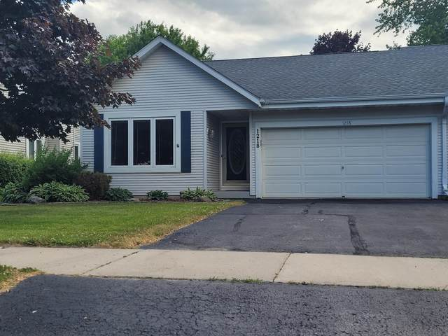 1218 Vogt Dr, West Bend, WI 53095 (#1749557) :: RE/MAX Service First