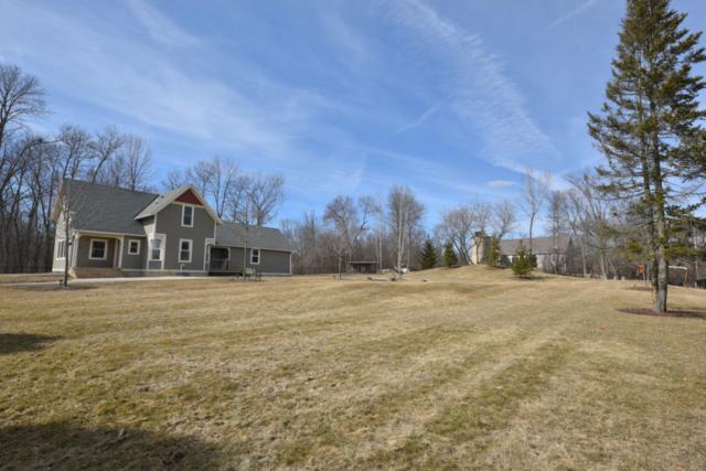 7018 Pioneer Rd, Cedarburg, WI 53012 (#1571889) :: Tom Didier Real Estate Team