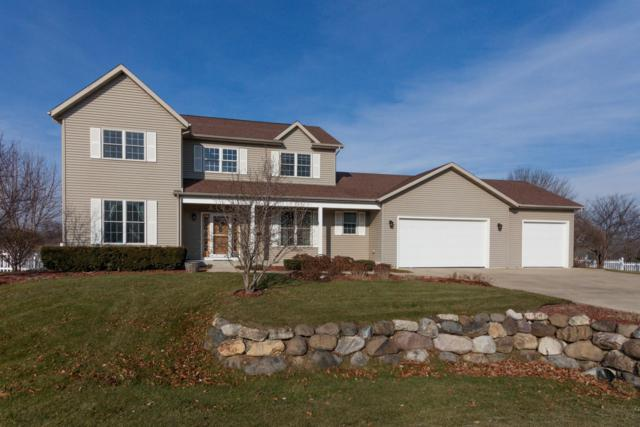 W8210 Bridle Path, Lake Mills, WI 53551 (#1616822) :: Tom Didier Real Estate Team
