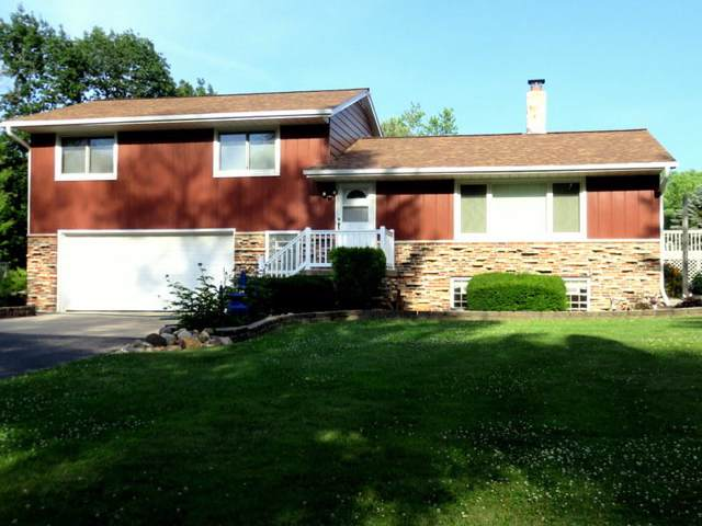 N8124 N Rock River Rd, Ixonia, WI 53036 (#1635844) :: Tom Didier Real Estate Team
