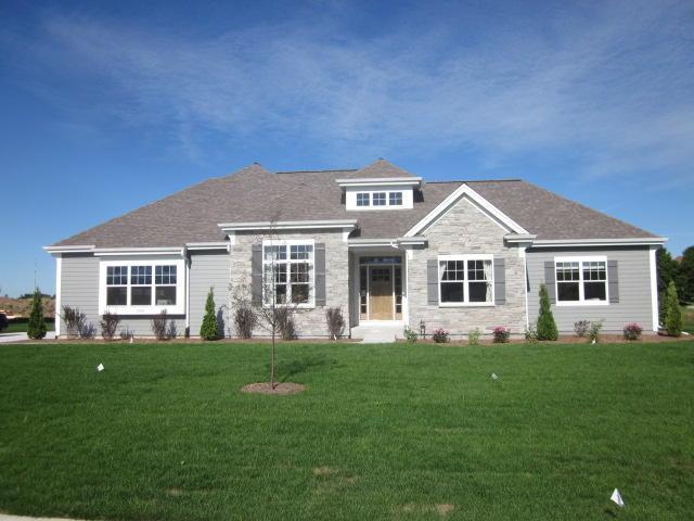 10941 N Highlander Dr, Mequon, WI 53097 (#1600551) :: Tom Didier Real Estate Team