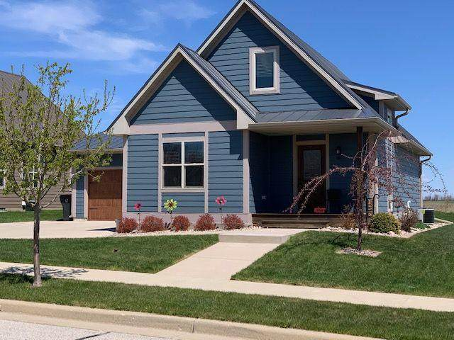 136 Peter Thein Ave, Belgium, WI 53004 (#1688230) :: Tom Didier Real Estate Team