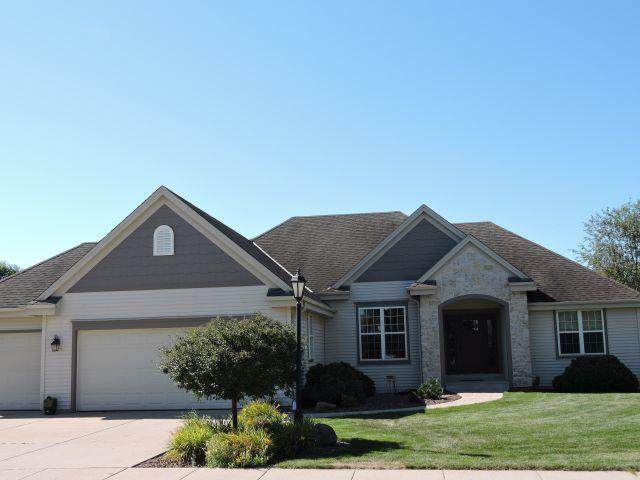 1229 Cardinal Dr, Oconomowoc, WI 53066 (#1705346) :: RE/MAX Service First Service First Pros