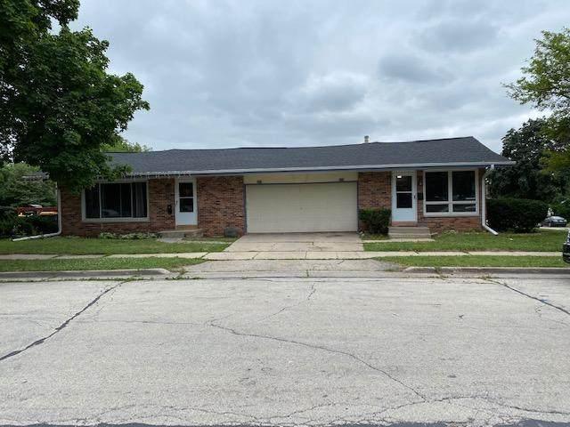 321 Rivera Dr #323, Waukesha, WI 53189 (#1751462) :: Tom Didier Real Estate Team