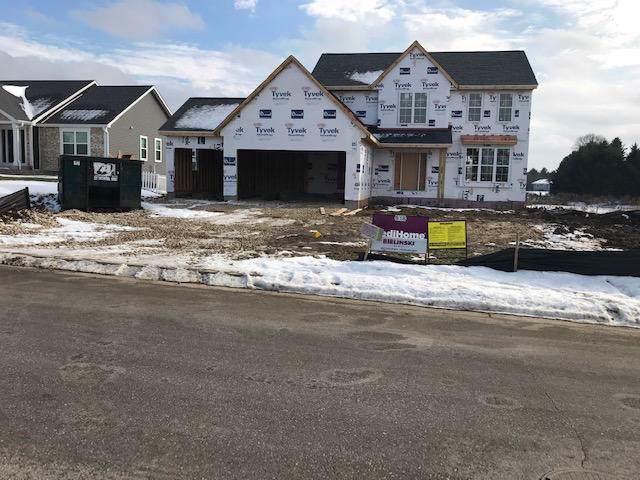 518 Spur N Rd, Slinger, WI 53086 (#1667358) :: Tom Didier Real Estate Team