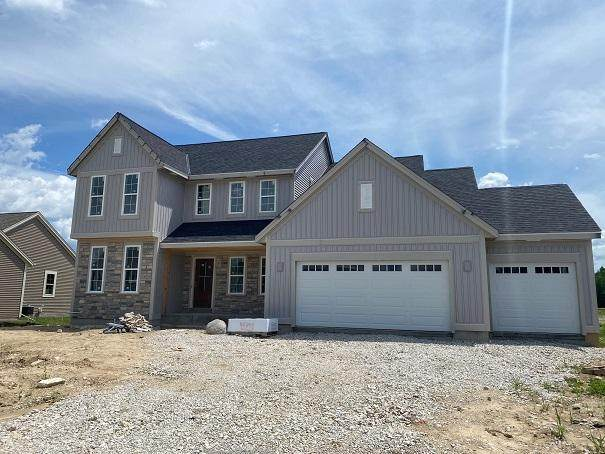 W223N4648 Seven Oaks Dr, Pewaukee, WI 53072 (#1684607) :: NextHome Prime Real Estate
