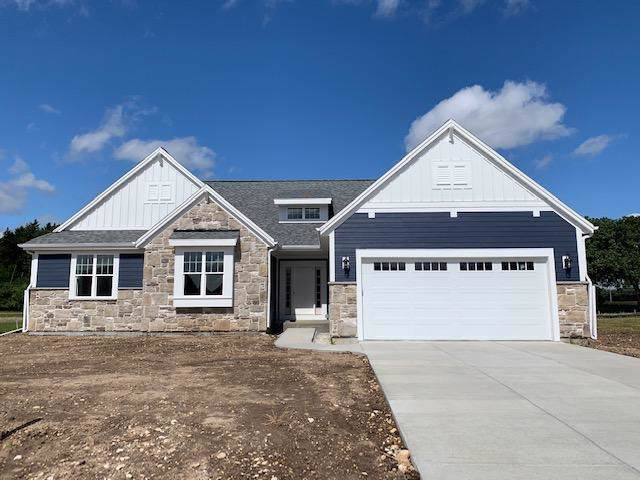 35418 Mineral Springs Blvd, Summit, WI 53066 (#1655993) :: RE/MAX Service First Service First Pros