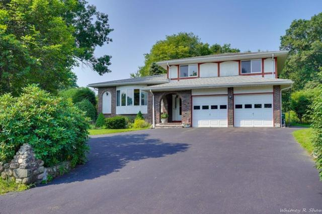65 Mill Pond Lane, Norwood, MA 02062 (MLS #72380326) :: The Goss Team at RE/MAX Properties