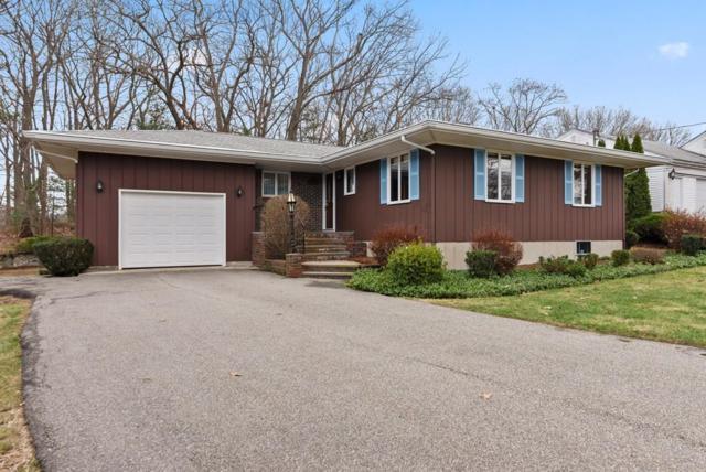 11 Heather Ln, Wakefield, MA 01880 (MLS #72429960) :: COSMOPOLITAN Real Estate Inc