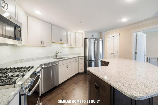 11 Cushing Place #201, Chelmsford, MA 01824 (MLS #72502446) :: Parrott Realty Group
