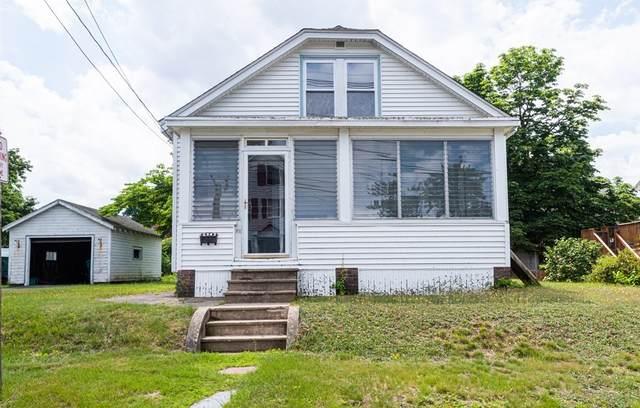 52 Magnolia, Lowell, MA 01854 (MLS #72852082) :: Spectrum Real Estate Consultants