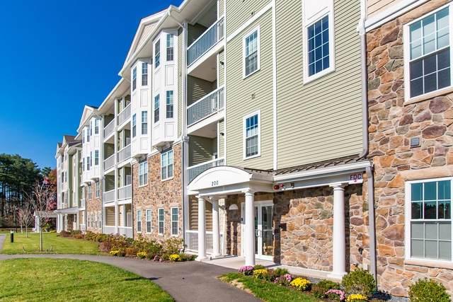 250 Martins Landing #211, North Reading, MA 01864 (MLS #72872210) :: Maloney Properties Real Estate Brokerage