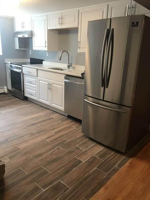 56 Bryon Rd #2, Boston, MA 02467 (MLS #72704009) :: Conway Cityside