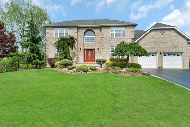 121 Cheyenne Drive, Morganville, NJ 07751 (MLS #21716227) :: The Dekanski Home Selling Team