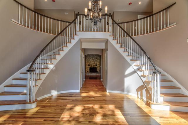11 Taylor Lake Court, Manalapan, NJ 07726 (MLS #21733588) :: The Dekanski Home Selling Team